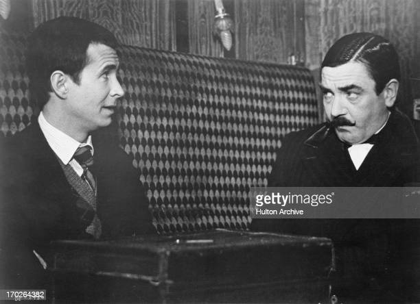 Actors Anthony Perkins , and Albert Finney in a scene from Agatha Christie's 'Murder On The Orient Express', 1974.