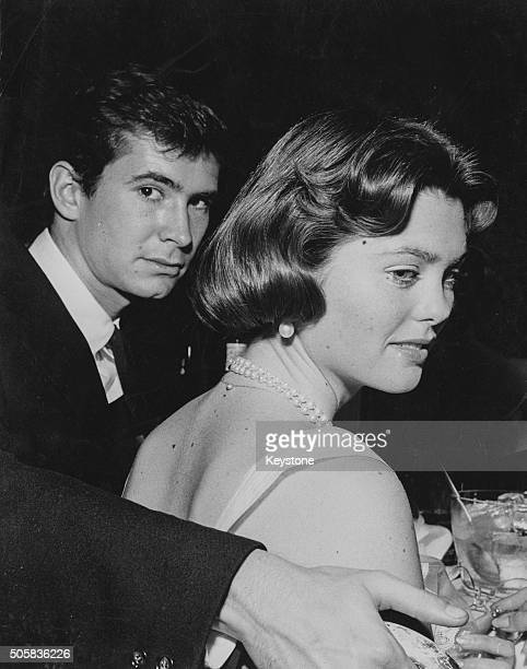 Actors Anthony Perkins and Maria Cooper daughter of actor Gary Cooper pictured together at a party in Hollywood circa 1955