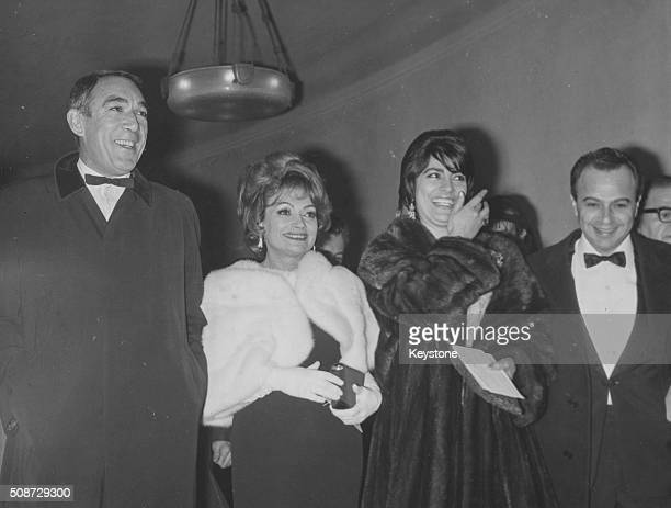 Actors Anthony Quinn Lila Kedrova and Irene Papas with film director Michael Cacoyannis at the premiere of their film 'Zorba the Greek' at the...