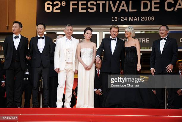 Actors Anthony Wong Simon Yam SiuFai Cheung Michelle Ye actor and singer Johnny Hallyday his wife Laeticia Hallyday and director Johnnie To attend...