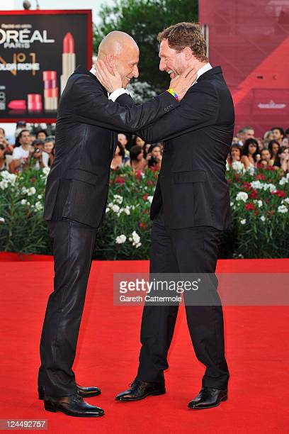 Actors Anton Adasinskiy and Johannes Zeiler attend the Damsels In Distress premiere and closing ceremony during the 68th Venice Film Festival at...