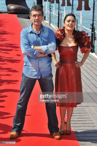 Actors Antonio Banderas and Salma Hayek attend the 'Puss in Boots' Photocall at Carlton Beach during the 64th Cannes Film Festival on May 11 2011 in...