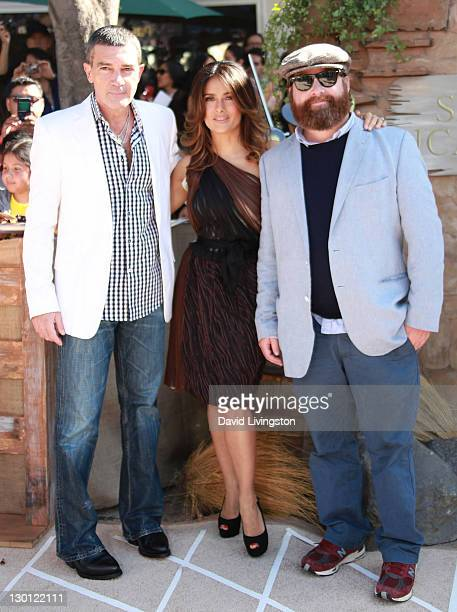 """Actors Antonio Banderas, Salma Hayek and Zach Galifianakis attend the premiere of Dreamworks Animation's """"Puss In Boots"""" at the Regency Village..."""