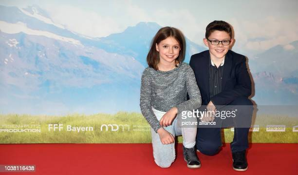 Actors Anuk Steffen and Quirin Agrippi pose on the red carpet during the German premiere of 'Heidi' in the Mathaeser Kino in Munich Germany 29...