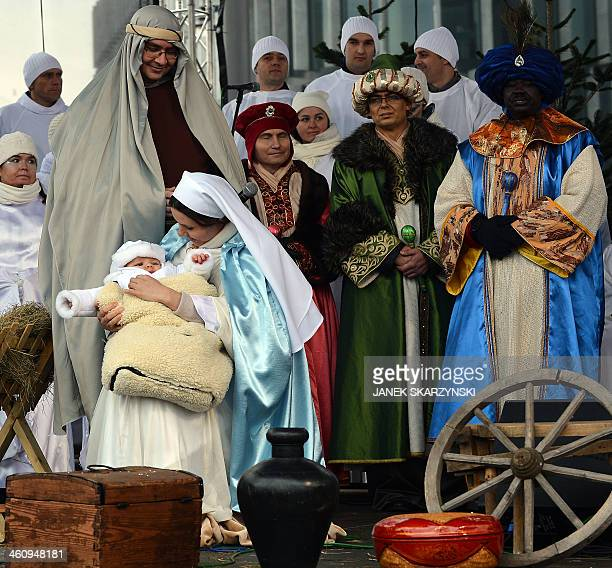 Actors are dressed as the Three Magi and members of the Holy Family during Epiphany celebrations in Warsaw's Old Town on January 6 2014 During...