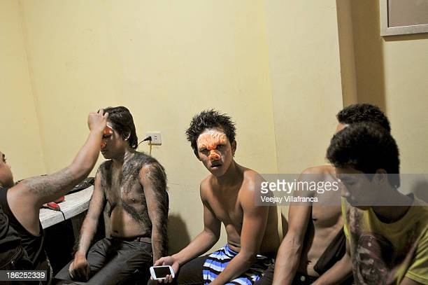 Actors are prepared for a scene with heavy character prosthetics during a popular TV series shoot on October 16 2013 in Manila Philippines The...