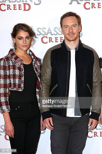Actors Ariane Labed and Michael Fassbender attend the 'Assassin's Creed' Paris Photocall at Hotel Bristol on December 5 2016 in Paris France