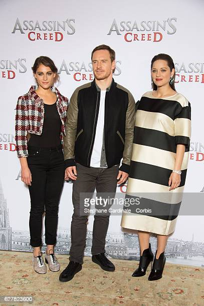 Actors Ariane Labed Michael Fassbender and Marion Cotillard attend the 'Assassin's Creed' Paris Photocall at Hotel Bristol on December 5 2016 in...