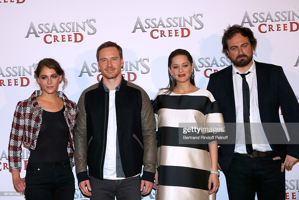 Actors Ariane Labed, Michael Fassbender, Marion Cotillard and director Justin Kurzel attend the 'Assassin's Creed' Paris Photocall at Hotel Bristol on December 5, 2016 in Paris, France.