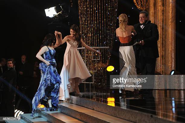Actors Ariel Winter and Sarah Hyland accept their award from Juile Bowen and John Goodman onstage during 20th Annual Screen Actors Guild Awards at...