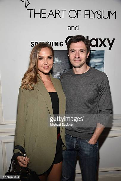 Actors Arielle Kebbel and Topher Grace attend an introduction to HEAVEN 2016 presented by The Art of Elysium and Samsung Galaxy on June 18 2015 in...