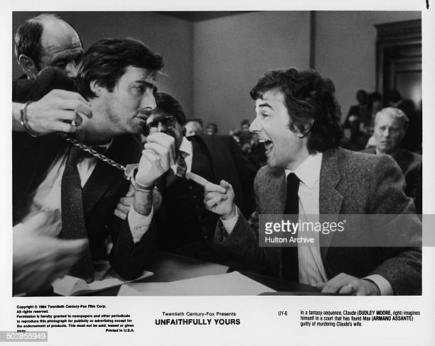 Actors Armand Assante and Dudley Moore in a court scene during the 20th Century Fox movie ' Unfaithfully Yours' circa 1984