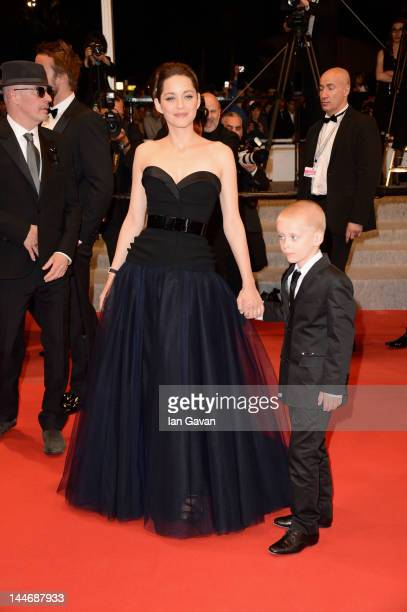 Actors Armand Verdure Marion Cotillard and director Jacques Audiard attend the De Rouille et D'os Premiere during the 65th Annual Cannes Film...