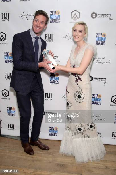 Actors Armie Hammer and Saoirse Ronan pose backstage during IFP's 27th Annual Gotham Independent Film Awards on November 27 2017 in New York City