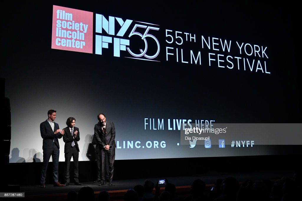 Actors Armie Hammer and Timothee Chalamet look on as director Luca Guadagnino speaks at the intro for a screening of 'Call Me by Your Name' during the 55th New York Film Festival at Alice Tully Hall on October 3, 2017 in New York City.