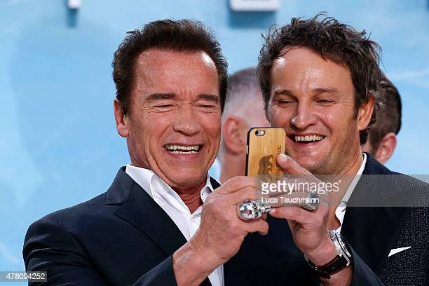 Actors Arnold Schwarzenegger and Jason Clarke take a picture with a smartphone during the European Premiere of 'Terminator Genisys' at the CineStar...