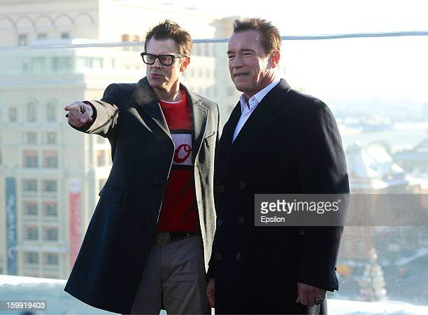 Actors Arnold Schwarzenegger and Johnny Knoxville attend the 'The Last Stand' photocall at the roof of RitzCarlton hotel on January 23 2013 in Moscow...