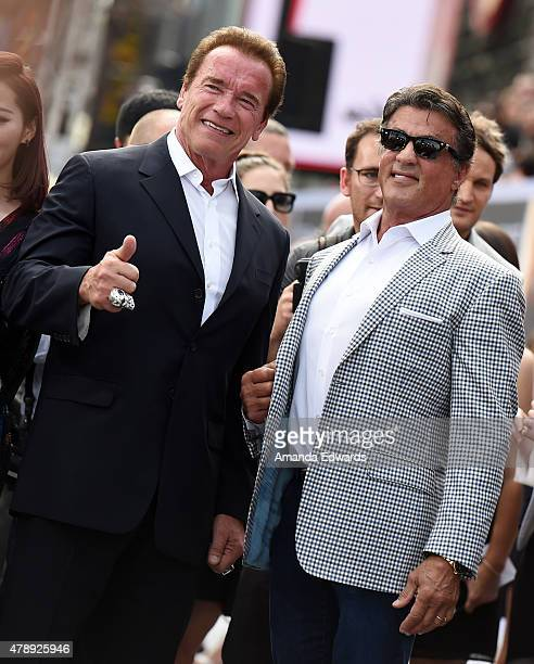 Actors Arnold Schwarzenegger and Sylvester Stallone arrive at the Los Angeles premiere of Terminator Genisys at The Dolby Theatre on June 28 2015 in...