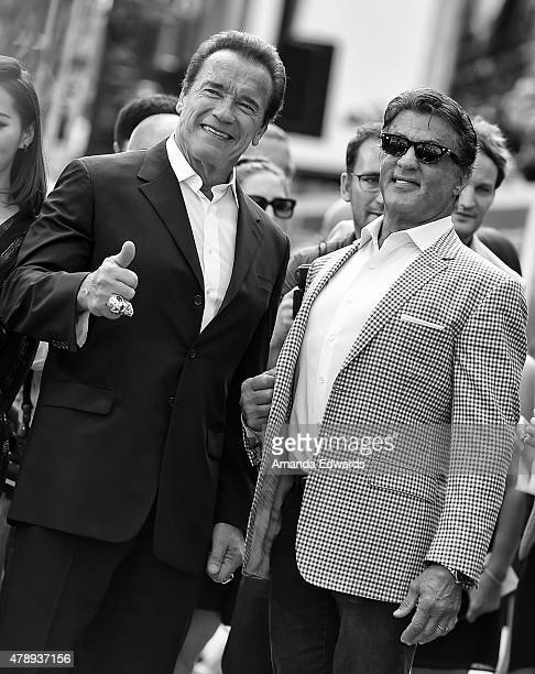 Actors Arnold Schwarzenegger and Sylvester Stallone arrive at the Los Angeles premiere of 'Terminator Genisys' at The Dolby Theatre on June 28 2015...