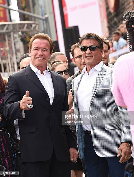 Actors Arnold Schwarzenegger and Sylvester Stallone arrive at the premiere of Paramount Pictures' Terminator Genisys at the Dolby Theatre on June 28...