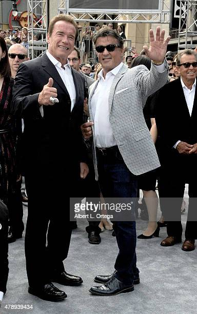 Actors Arnold Schwarzenegger and Sylvester Stallone arrive for the premiere of Paramount Pictures' Terminator Genisys held at Dolby Theatre on June...