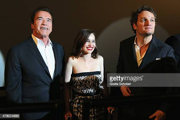 Actors Arnold Schwarzenegger Emilia Clarke and Jason Clarke attend the European Premiere of 'Terminator Genisys' at the CineStar Sony Center on June...