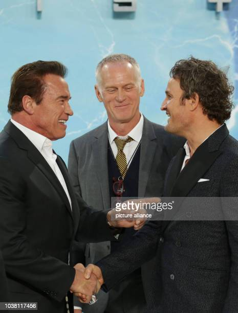 Actors Arnold Schwarzenegger Jason Clarke and director Alan Taylor arrive to the European premiere of the film 'Terminator Genisys' in Berlin Germany...