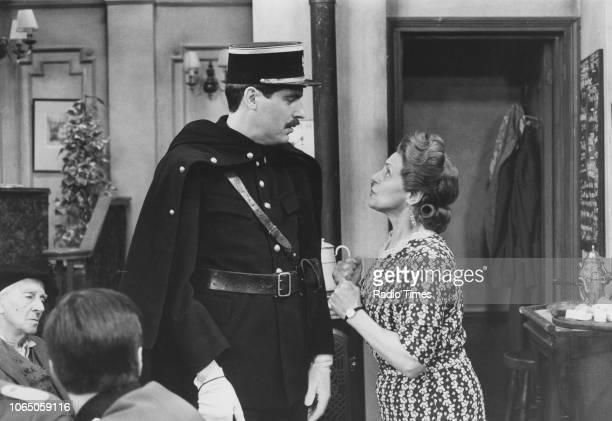 Actors Arthur Bostrom and Carmen Silvera in a scene from the television sitcom ''Allo 'Allo' May 17th 1985