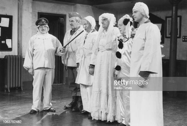 Actors Arthur Lowe John Le Mesurier Clive Dunn John Laurie Arnold Ridley and Ian Lavender wearing homemade snow camouflage in a scene from the 'Dad's...