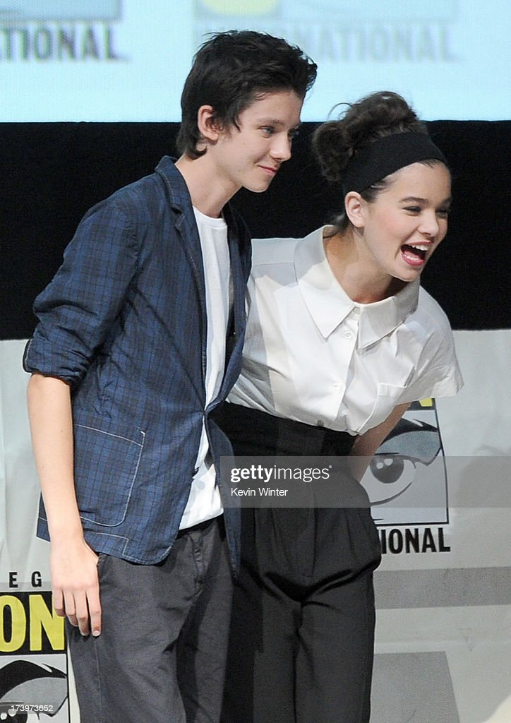 Actors Asa Butterfield and Hailee Steinfeld pose onstage at the 'Enders Game' and 'Divergent' panels during Comic-Con International 2013 at San Diego Convention Center on July 18, 2013 in San Diego, California.