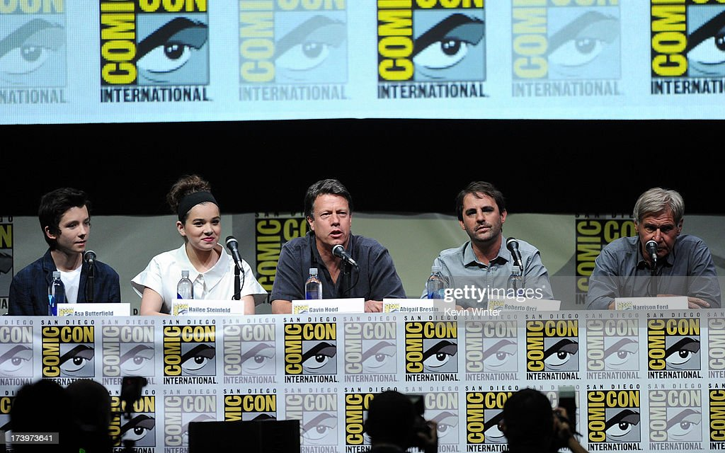 Actors Asa Butterfield, Hailee Steinfeld, writer/director Gavin Hood, producer Roberto Orci, and actor Harrison Ford speak onstage at the 'Enders Game' and 'Divergent' panels during Comic-Con International 2013 at San Diego Convention Center on July 18, 2013 in San Diego, California.