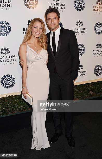 Actors Ashley Hinshaw and Topher Grace arrive at The Art of Elysium presents Stevie Wonder's HEAVEN - Celebrating the 10th Anniversary at Red Studios...