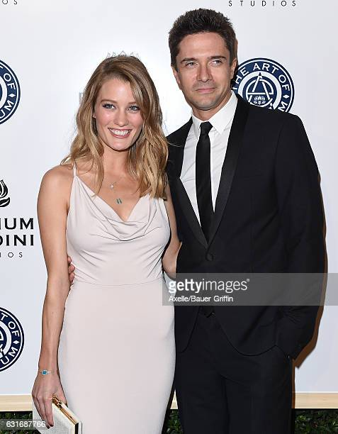 Actors Ashley Hinshaw and Topher Grace arrive at The Art of Elysium celebrating the 10th Anniversary at Red Studios on January 7, 2017 in Los...