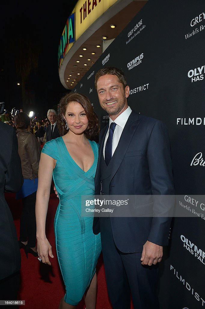 Actors Ashley Judd (L) and Gerard Butler attend Brioni Sponsors Film District's World Premiere Of 'Olympus Has Fallen' ArcLight Cinemas on March 18, 2013 in Hollywood, California.