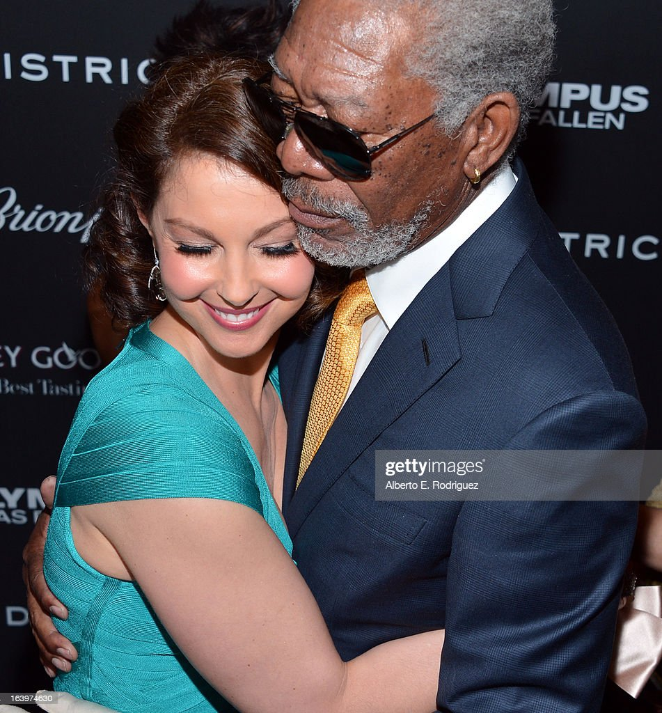 Actors Ashley Judd (L) and Morgan Freeman arrive at the premiere of FilmDistrict's 'Olympus Has Fallen' at ArcLight Cinemas Cinerama Dome on March 18, 2013 in Hollywood, California.