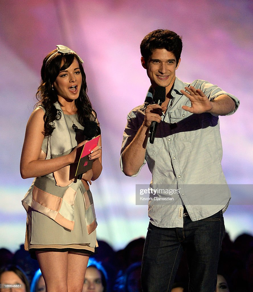 Actors Ashley Rickards (L) and Tyler Posey speak onstage during the 2013 MTV Movie Awards at Sony Pictures Studios on April 14, 2013 in Culver City, California.