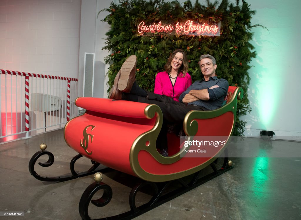 Actors Ashley Williams and Dermot Mulroney attend the opening of Hallmark's Museum of Christmas on November 14, 2017 in New York City.