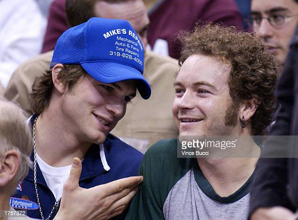 Actors Ashton Kutcher and Danny Masterson watch the Utah Jazz play the Los Angeles Lakers on February 1 2003 at Staples Center in Los Angeles...