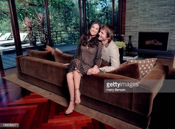 Actors Ashton Kutcher and Demi Moore are photographed at home for Architectural Digest on October 19 2006 in Beverly Hills California