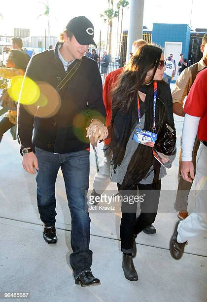 Actors Ashton Kutcher and Demi Moore are seen at Super Bowl XLIV at Sun Life Stadium on February 7, 2010 in Miami Gardens, Florida.
