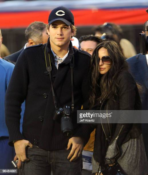 Actors Ashton Kutcher and Demi Moore are seen on the sideline at Super Bowl XLIV at Sun Life Stadium on February 7 2010 in Miami Gardens Florida