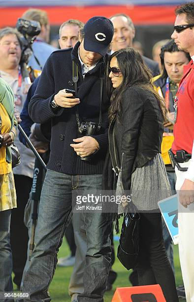 Actors Ashton Kutcher and Demi Moore are seen on the sideline at Super Bowl XLIV at Sun Life Stadium on February 7, 2010 in Miami Gardens, Florida.