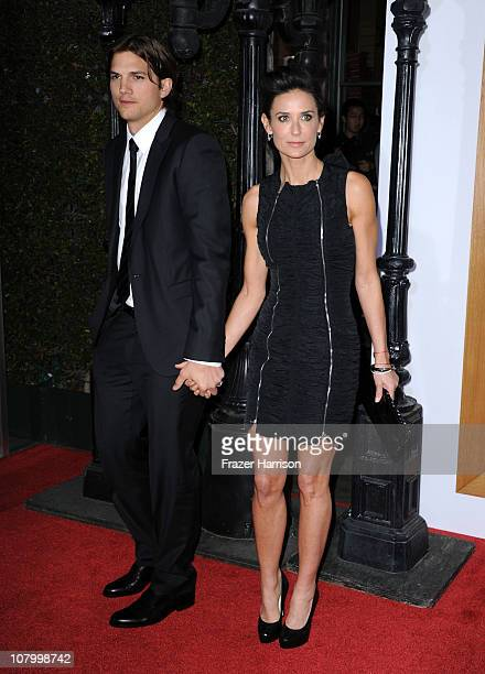 Actors Ashton Kutcher and Demi Moore arrive at Paramount Pictures' 'No Strings Attached' premiere at Regency Village Theater on on January 11 2011 in...