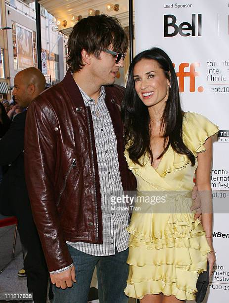 Actors Ashton Kutcher and Demi Moore arrive to 'The Joneses' premiere during the 2009 Toronto International Film Festival held at The Elgin on...