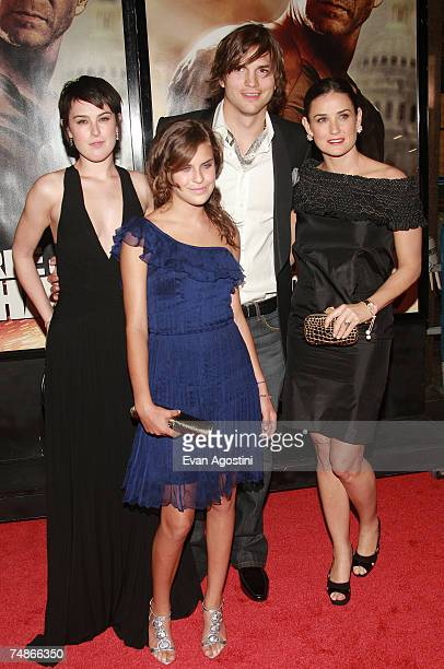 Actors Ashton Kutcher and Demi Moore pose with her children Rumer and Tallulah Belle Willis at the premiere of Live Free Or Die Hard presented by...