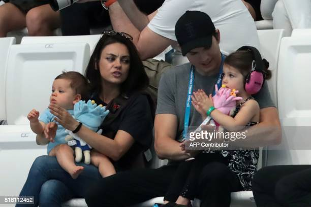 Actors Ashton Kutcher and his wife Mila Kunis attend the diving competition at the 2017 FINA World Championships in Budapest, on July 17, 2017. / AFP...