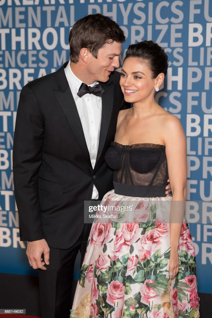 Actors Ashton Kutcher and Mila Kunis arrive at the 2018 Breakthrough Prize at NASA Ames Research Center on December 3, 2017 in Mountain View, California.