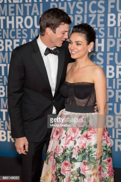 Actors Ashton Kutcher and Mila Kunis arrive at the 2018 Breakthrough Prize at NASA Ames Research Center on December 3 2017 in Mountain View California