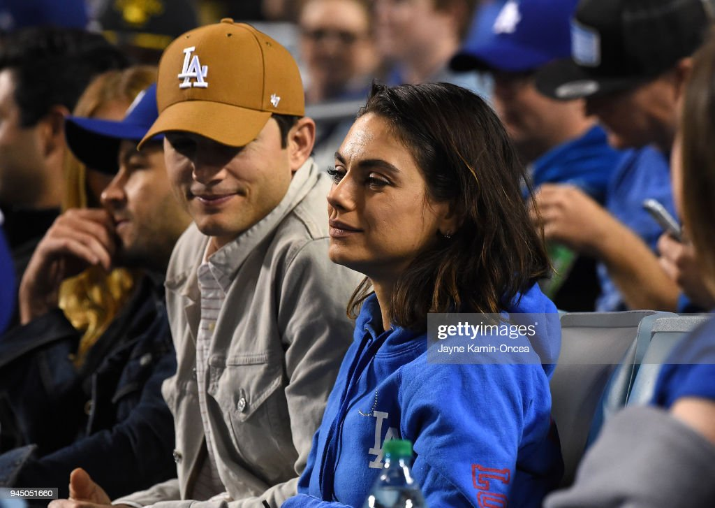 Actors Ashton Kutcher and Mila Kunis attend the game between the Los Angeles Dodgers and the Oakland Athletics at Dodger Stadium on April 11, 2018 in Los Angeles, California.