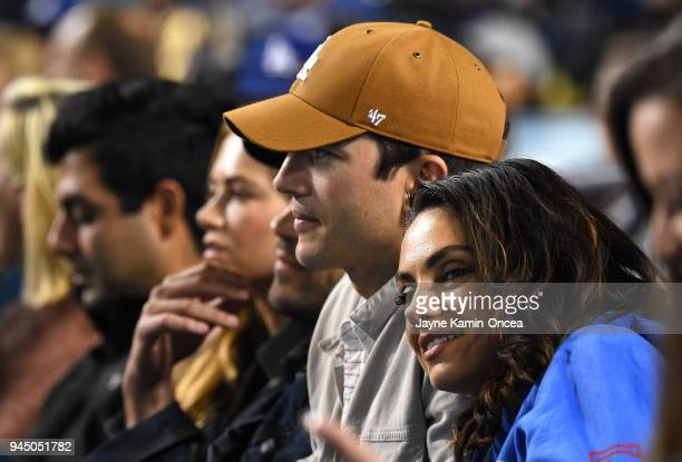 Actors Ashton Kutcher and Mila Kunis attend the game between the Los Angeles Dodgers and the Oakland Athletics at Dodger Stadium on April 11 2018 in...